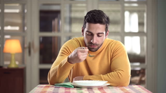 man vs zuppa - sitting video stock e b–roll