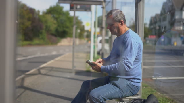 man waiting for transportation - one mid adult man only stock videos & royalty-free footage