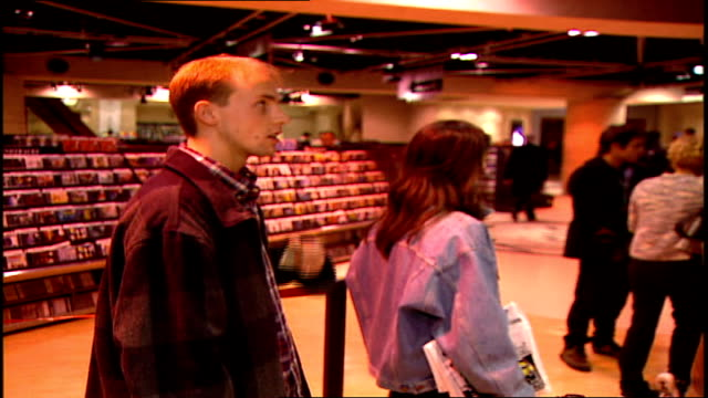 man waiting in line to buy a cd in music store - compact disc stock videos & royalty-free footage