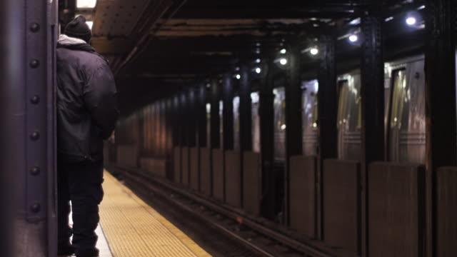 Man waits for subway 4K