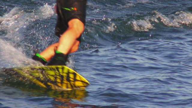 hd man wakeboarding on lake slow motion - waterskiing stock videos & royalty-free footage
