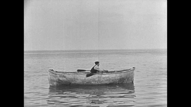 1923 Man (Buster Keaton) wakes alone in lifeboat and begins rowing
