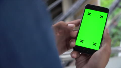 man walk down and looking at green screen phone - staircase stock videos & royalty-free footage