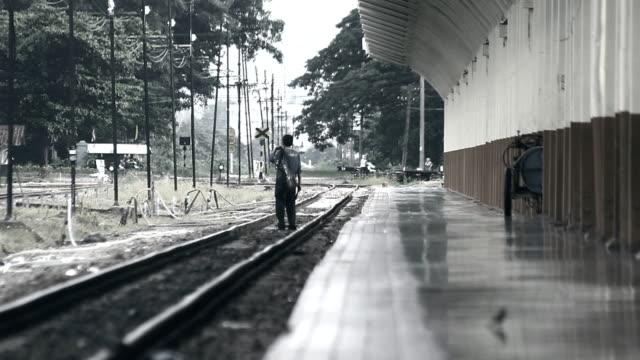 man walk on railway