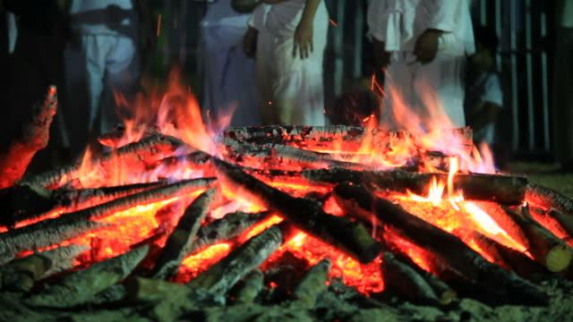 man walk through the bonfire - coal stock videos & royalty-free footage