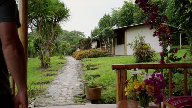 ms pov man walking along an ecotourism resort / tena, napo, ecuador - ecuador stock videos & royalty-free footage