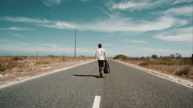 man walking along road - escaping stock videos & royalty-free footage