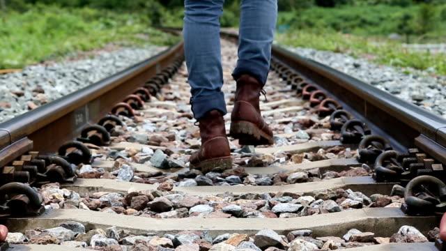 Man walking along the railroad in rural.