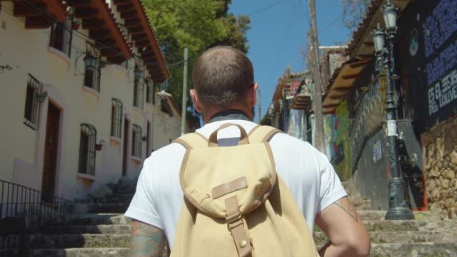 vídeos y material grabado en eventos de stock de man walking at san cristobal de las casas. following in a rear view. iconic image of mexico - tourism