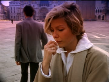 man walking away from close up crying blonde woman in foreground / piazza san marco / venice, italy - girlfriend stock videos & royalty-free footage