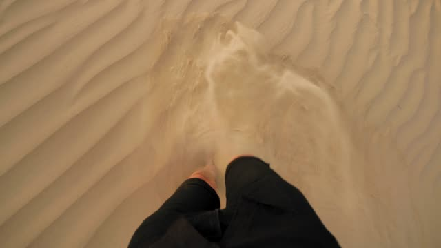 man walking barefoot in the desert pov - stepping stock videos & royalty-free footage