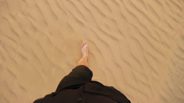 man walking barefoot in the desert pov - human limb stock videos & royalty-free footage