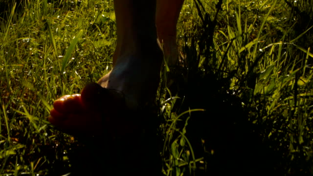 man walking barefoot - grass stock videos & royalty-free footage