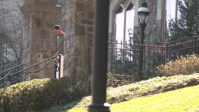 ms ts man walking down campus stairs, bethlehem, pennsylvania, usa - see other clips from this shoot 1503 stock videos and b-roll footage