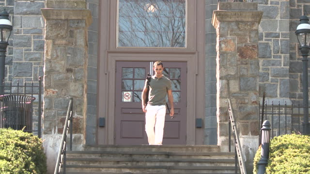 ms td man walking down campus stairs, bethlehem, pennsylvania, usa - see other clips from this shoot 1503 stock videos and b-roll footage