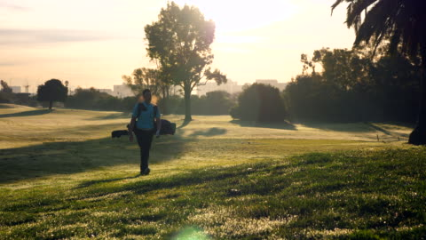 ws man walking down fairway during early morning round of golf - golfer stock videos & royalty-free footage