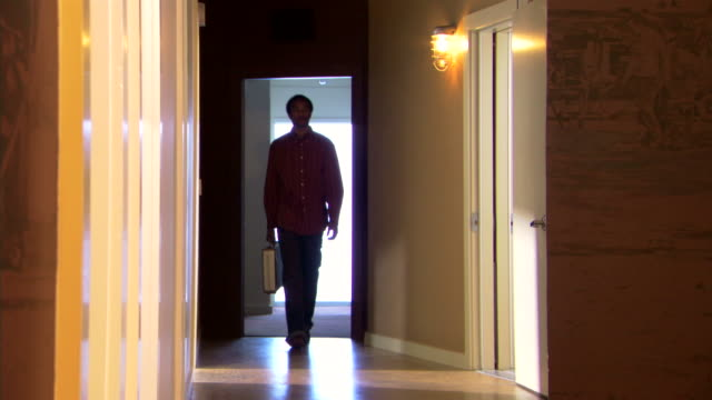 man walking down hall with briefcase - briefcase stock videos & royalty-free footage