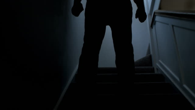 man walking downstairs. silhouette. - limb body part stock videos & royalty-free footage