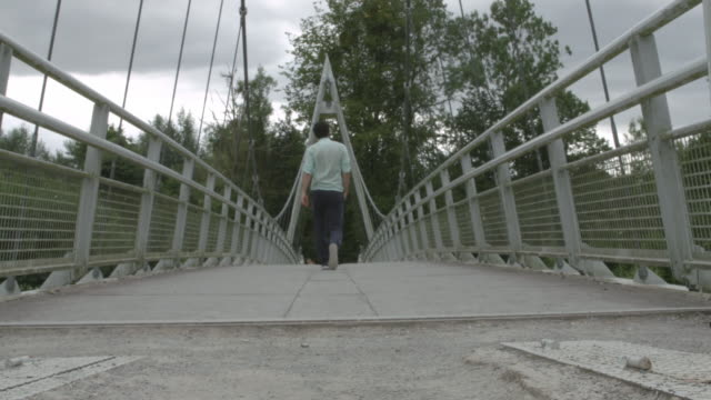 man walking forward on bridge - lebanese ethnicity stock videos and b-roll footage