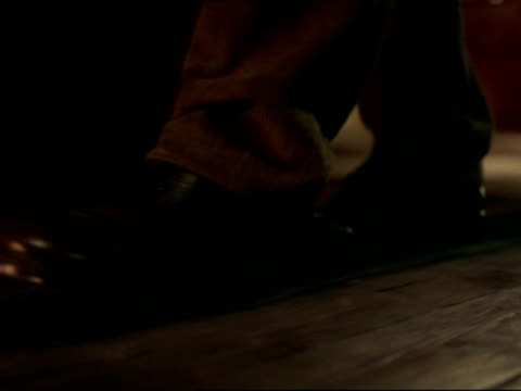 stockvideo's en b-roll-footage met cu, man walking in line on wooden floor - houten vloer