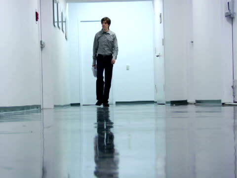 MS, Man walking in office corridor