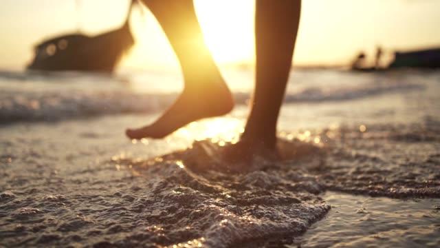 man walking in shallow water - barefoot stock videos & royalty-free footage
