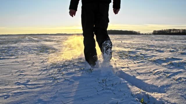 ws man walking in snow - footprint stock videos & royalty-free footage