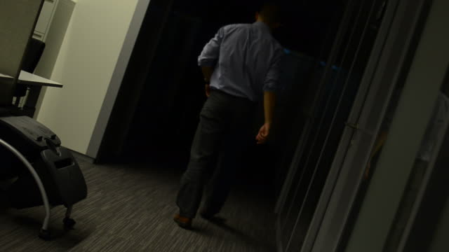 man walking in the hallway - automatic stock videos & royalty-free footage