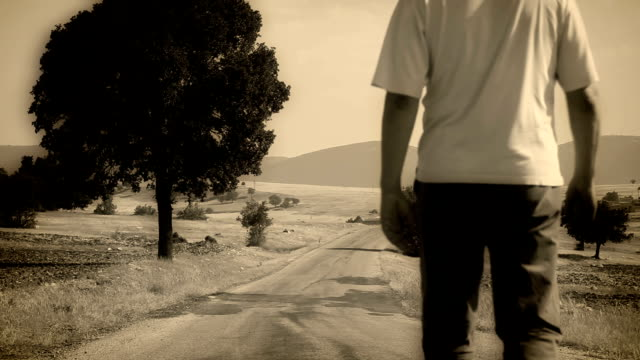 man walking in the way - sepia stock videos & royalty-free footage