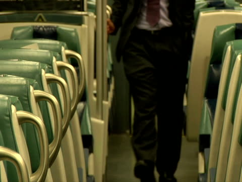 stockvideo's en b-roll-footage met slo mo, ms, man walking in train aisle, mid section, chappaqua, new york state, usa - compleet pak
