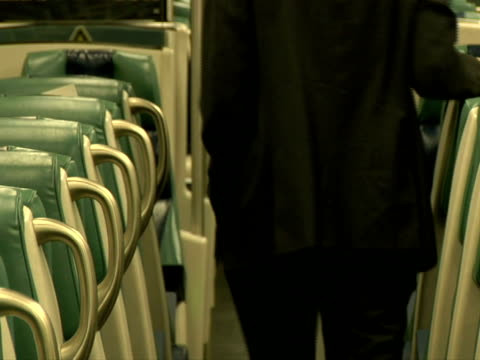 stockvideo's en b-roll-footage met slo mo, ms, man walking in train aisle, mid section, rear view, chappaqua, new york state, usa - compleet pak