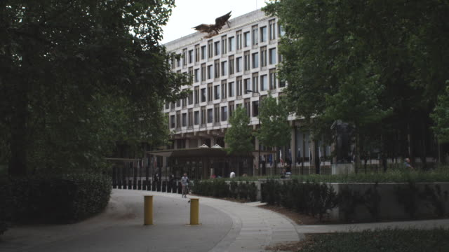 ms man walking infront of embassy building / london, england - embassy stock videos & royalty-free footage