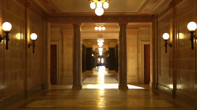 ms zo man walking inside capitol building hall / madison, wisconsin, united states - effetto zoom video stock e b–roll