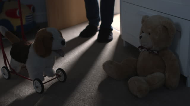 man walking into child's bedroom. low light and angle shot with toys on the floor. - slipper stock videos & royalty-free footage