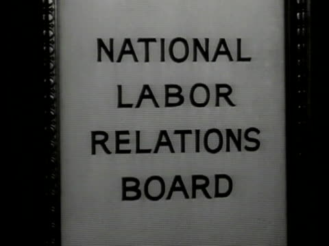 man walking into office w/ secretary cu door sign 'national labors relations board' vs harry a millis talking w/ board members at table - 1935 stock videos & royalty-free footage