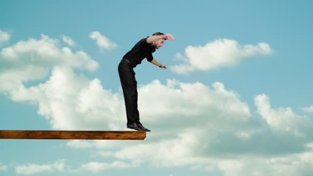 man walking on edge of plank - matte board stock videos & royalty-free footage
