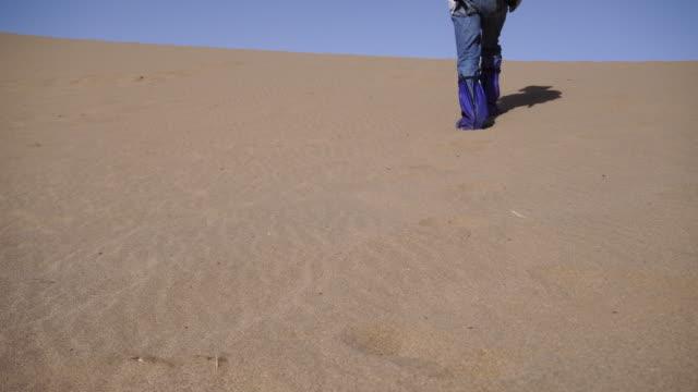 man walking on gobi desert - human foot stock videos & royalty-free footage