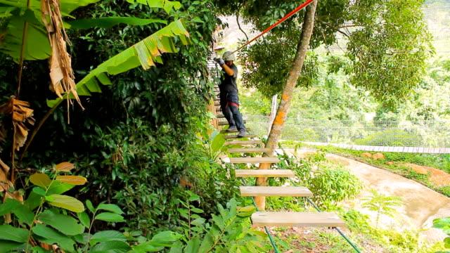 man walking on robe bridge - suspension bridge stock videos & royalty-free footage