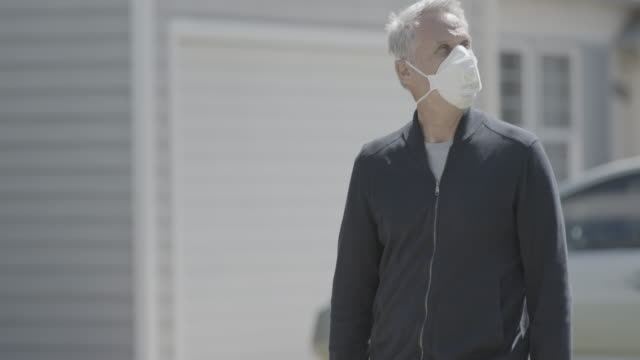 man walking on sidewalk with face mask - driveway stock videos & royalty-free footage
