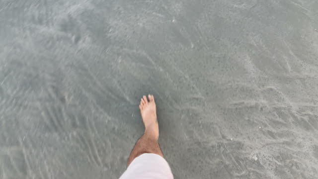 man walking on the beach - barefoot stock videos & royalty-free footage