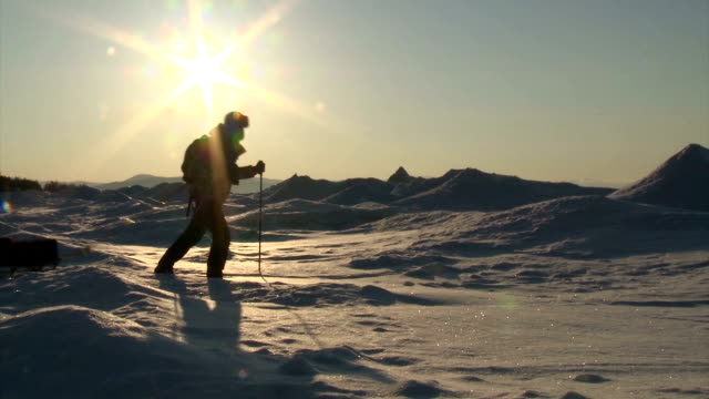 stockvideo's en b-roll-footage met man walking on the ice - exploration