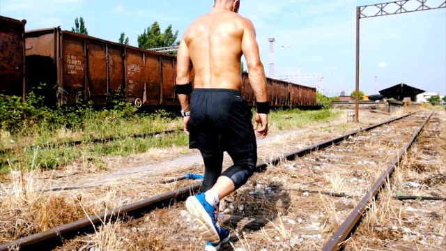 man walking on the railroad - tracksuit bottoms stock videos & royalty-free footage