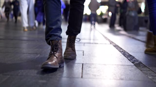 man walking on the street by night - arrangement stock videos & royalty-free footage