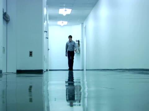 MS, Man walking through corridor