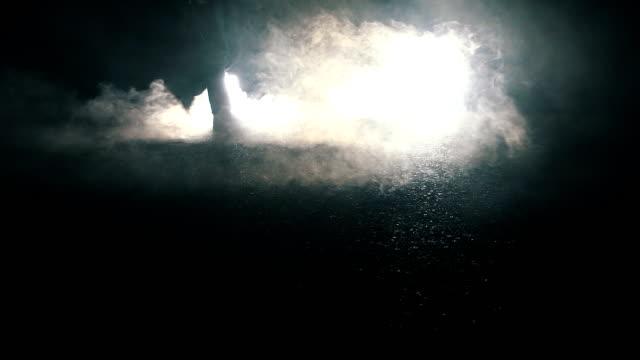man walking through light in dark night - footprint stock videos & royalty-free footage