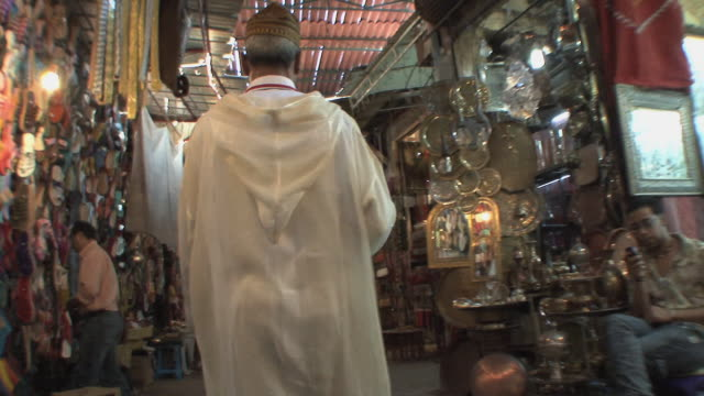 ms pov man walking through souk, marrakech, morocco - rear view stock videos & royalty-free footage