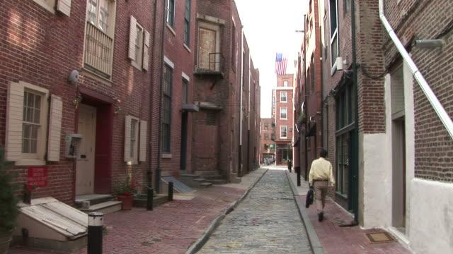 a man walking through the street in philadelphia united states - philadelphia pennsylvania stock videos & royalty-free footage