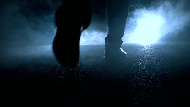 man walking towards light - footprint stock videos & royalty-free footage