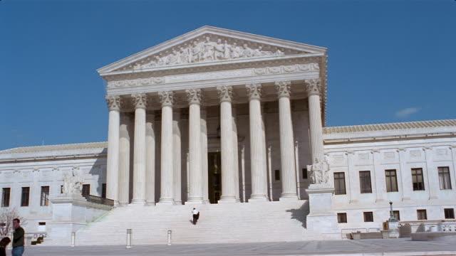 Man walking up steps to entrance of US Supreme Court building / Washington, DC