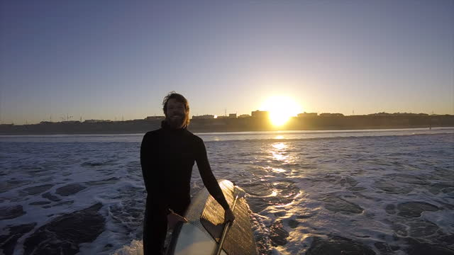 man walking with surfboard, sup stand-up paddleboard surfing pov at sunrise. - oar stock videos & royalty-free footage